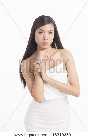 Pretty asian woman portrait with long straight hair on white background