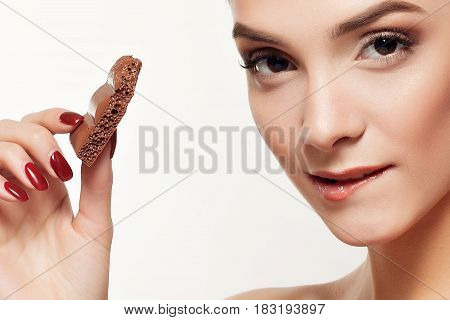 Lovely Smiling Teenage Girl Eating Chocolate