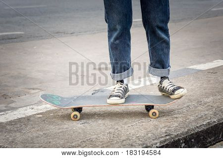 teenage skateboarder skateboarding at city on street