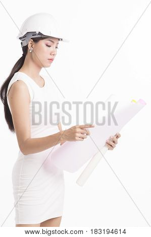 Sexy girl structural engineer looking at drafting paper white background photo