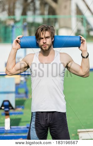 Man With Muscular Body, Beard Holding Yoga Or Fitness Mat