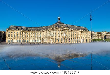 Water mirror fountain and Palais de la Bourse in Bordeaux - France