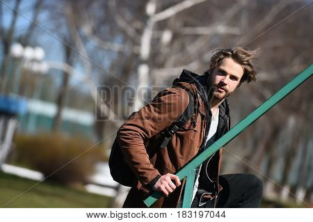 Bearded Man In Brown Hoodie Jacket With Sport Bag