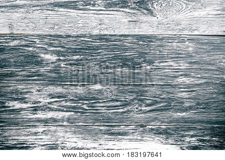 Black and white textured wood board background. Direct view