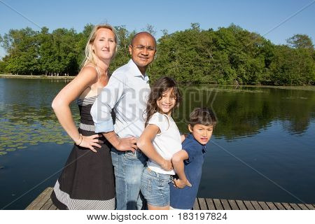 Mixed Race Racial Family Near The Lake With Blond And Indian
