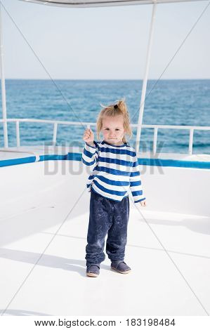 Fashionable Small Baby Boy On Yacht In Marine Shirt, Pants