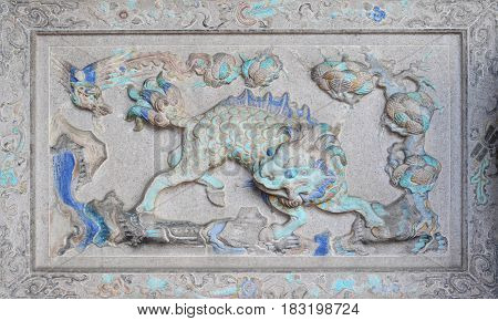Ancient sculpture of anmial on Chinese temple wall Penang Malaysia