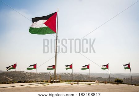 RAWABI, PALESTINIAN AUTHORITY. June 27, 2014. Palestinian national flag on the slope of the hill in the city of Rawabi built in the West bank (Samaria) not far from Ramallah. Stock image.