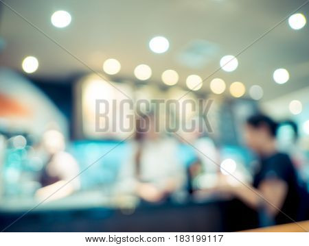 Blurred Background : Customer Order Beverage At Coffee Shop With Bokeh Light