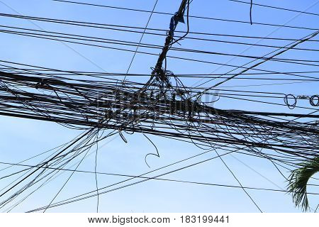 Tangled wires of telecommunication with blue sky
