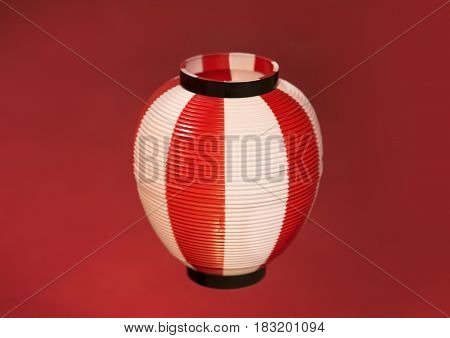 Asian Red Paper Lantern on red background.