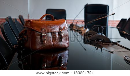 Fashion with brown leather bag in office
