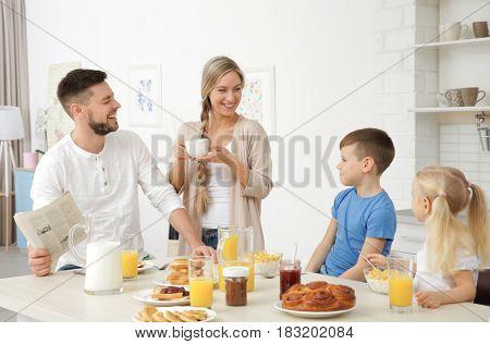 Happy family having breakfast on kitchen