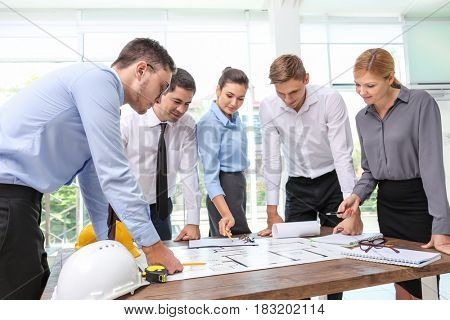 Engineers working with new project in office