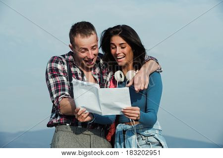 Happy Girl And Handsome Man Reading Paper Letter And Smiling