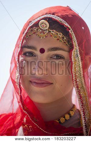JAISALMER INDIA - FEBRUARY 09 2017 : Indian girl wearing traditional Rajasthani dress participate in Desert Festival in Jaisalmer Rajasthan India
