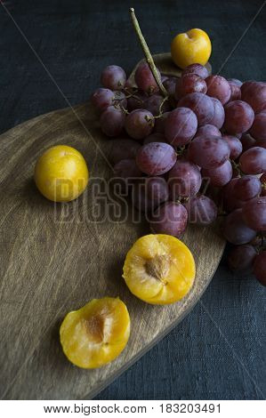 Grapes On A Wooden Board. On A Black Background