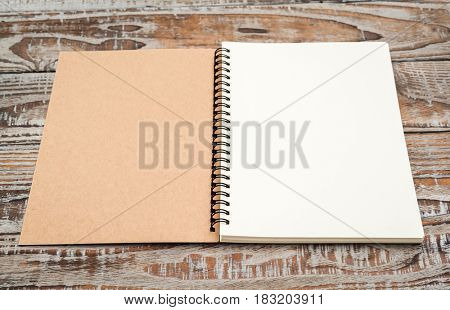 Blank notebook mock up on wood background