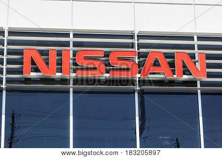 Indianapolis - Circa April 2017: Logo and Signage of a Nissan Car and SUV Dealership. Nissan is part of the Renault-Nissan Alliance I