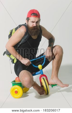 Bearded Angry Man With Bag, Apple On Bicycle Toy
