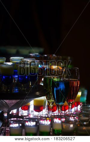 Colorful Cocktails And Layered Shots On Countertop