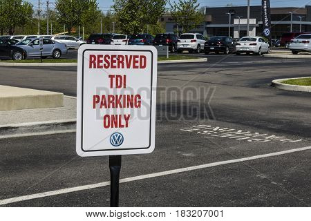 Indianapolis - Circa April 2017: Volkswagen Cars and SUV Dealership Sign allowing parking for TDI Only IX