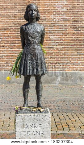 UTRECHT, NETHERLANDS - APRIL 09, 2017: Statue of Anne Frank holding flowers in Utrecht, Netherlands