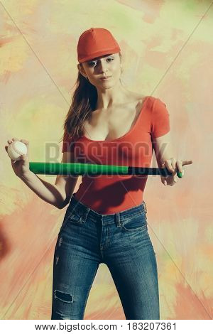 Pretty Girl In Red Cap With Green Bat And Ball