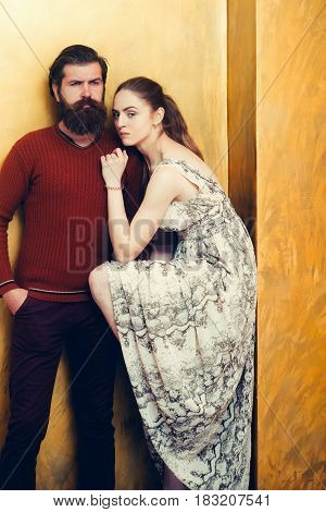 Serious Bearded Man And Pretty Girl With Raised Sexi Leg