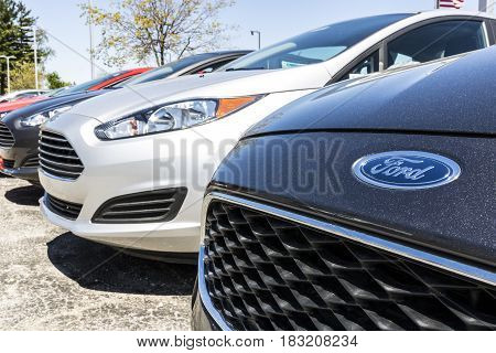 Indianapolis - Circa April 2017: A Local Ford Car and Truck Dealership. Ford sells products under the Lincoln and Motorcraft brands VI