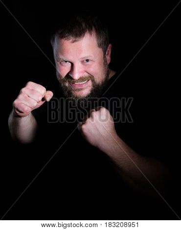Portrait of a fighter on black background