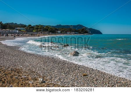 Summer vacationers on the beach of Portonovo, Monte Conero, Italy