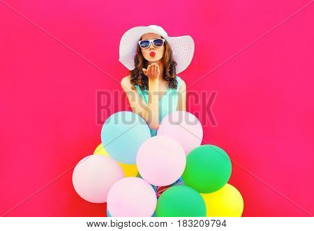 Fashion Woman Is Sends An Air Kiss Holds An Air Colorful Balloons On A Pink Background