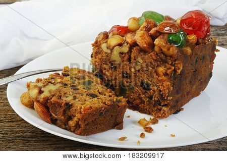 Fruit cake on white plate ,Christmas fruit cake