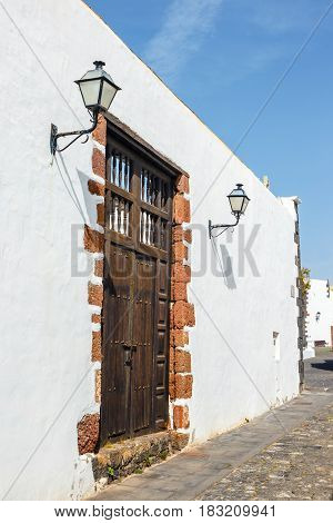 Old Brown Door  On White Wall Background