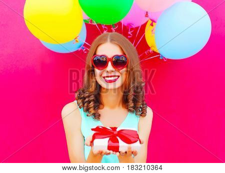 Portrait Happy Smiling Woman Holds In Hands A Gift Box Over An Air Colorful Balloons Pink Background