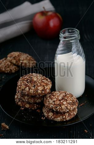 Still life with milk and homemade whole grain cookies