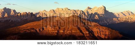 Evening red colored panoramic view of Gruppo di Tofana or Tofane Grupe alps dolomites mountains Italy