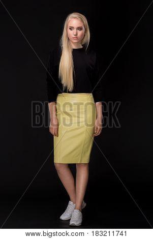 blonde woman posing Full-length on black background
