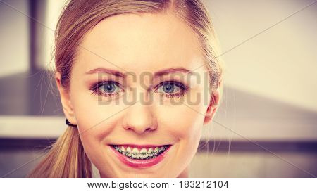 Happy Smiling Blonde Woman Having Braces