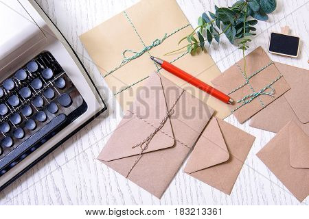 Rope-tied envelopes with pen on is are near interesting typewriter. Top view