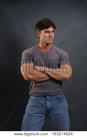 The cute sexy man is showing his muscles.