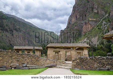 Ancient Inca constractions and mountains behind them