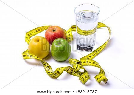 A Glass Of Water And Apples: Green, Red, Yellow With A Measuring Tape, Isolated.