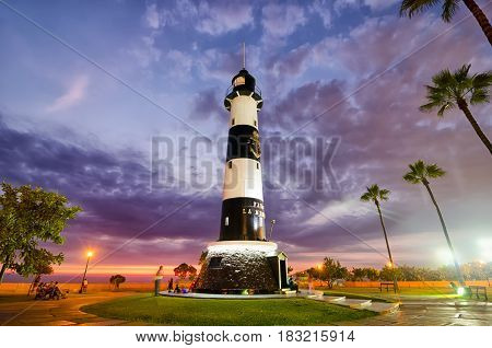 LIMA PERU 21 FEBRUARY 2017: view to light house at the sunset in Miraflores district at night