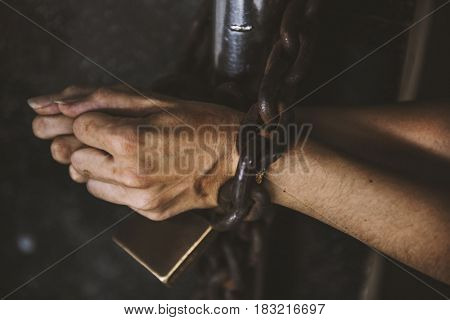 Two Hands got Chained with Padlock on Bars Prisoner