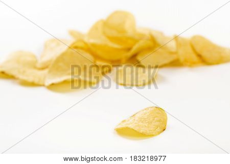 Crispy potato chips isolated on the white background  close-up