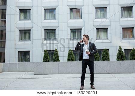 Full-length shot of businessman talking on phone