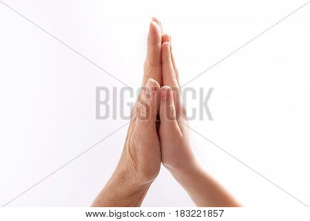 We are together despite ages. Wrinkled female palm is touching to smooth one of little girl. Isolated
