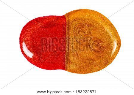 Blot of red and gold nail polish isolated on the white background